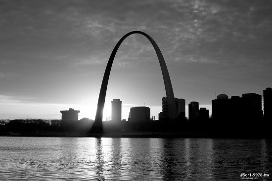 Riverfront sun behind Arch