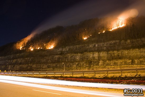 Wildfire near highway traffic