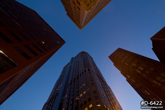 Looking up at skyscrapers at twilight