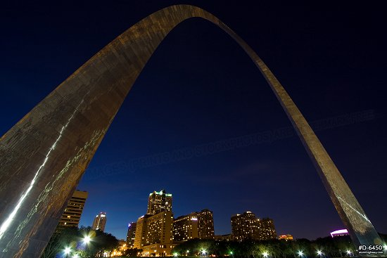 Arch closeup over city at twilight